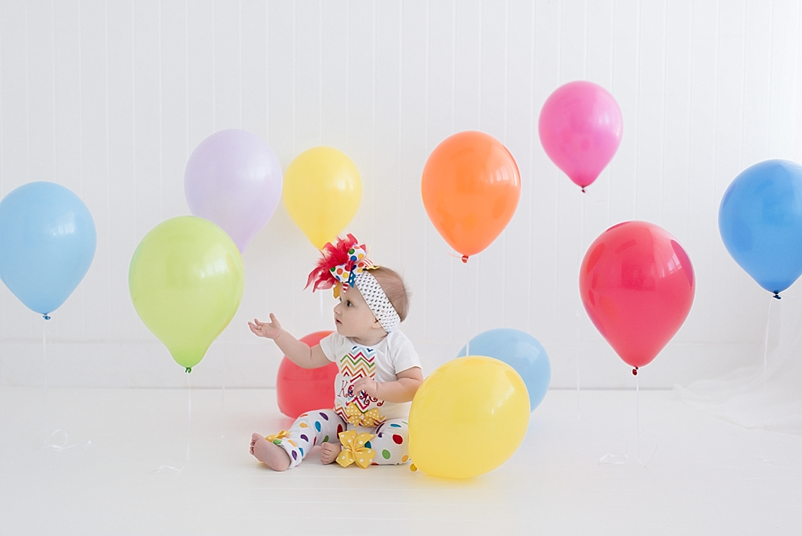 lots of balloons for a baby girls first birthday at natural light studio in pearland