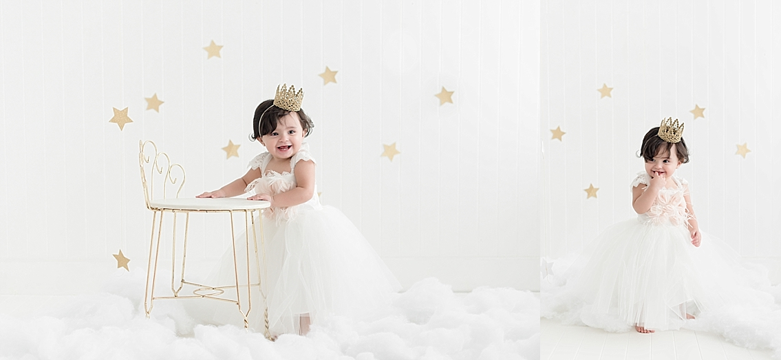 little girl in a dream set of clouds and stars at pearland photography studio