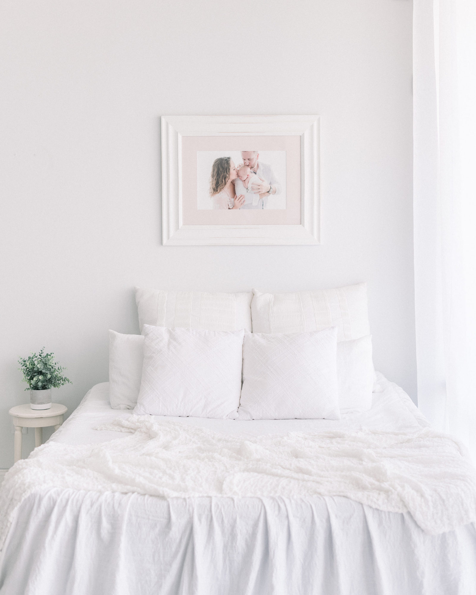 bed with framed print