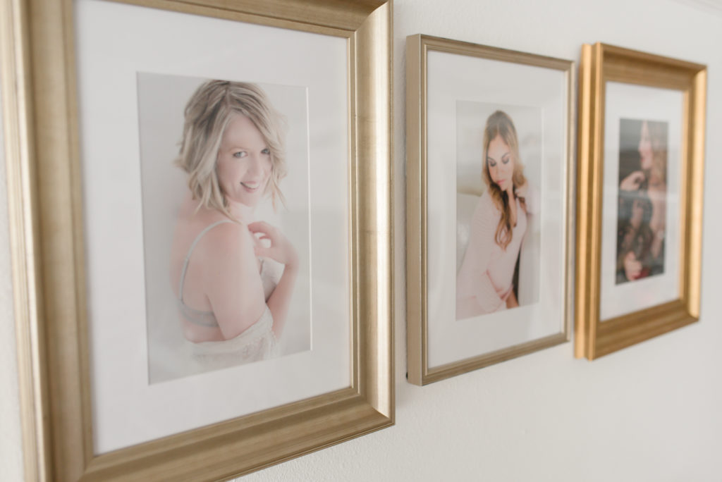 Frames of women on the wall